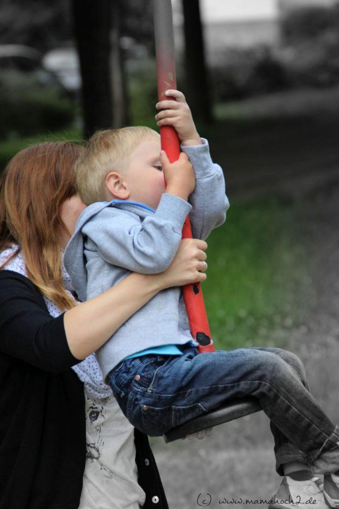 Mutter mit Kind Spielplatz